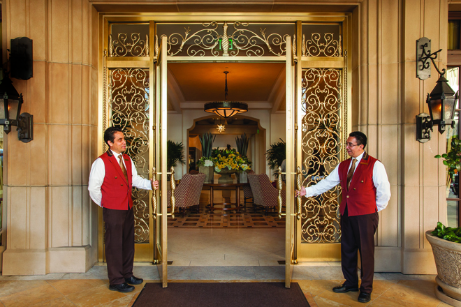 Front entrance of Montage Hotel in Beverly Hills, CA with two be