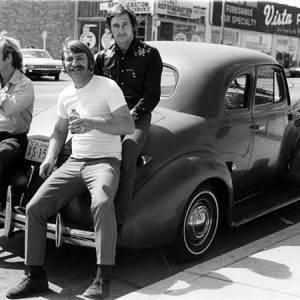 Joe Goode, Jerry McMillan, and Ed Ruscha with Ed's '39 Chevy, 1970.