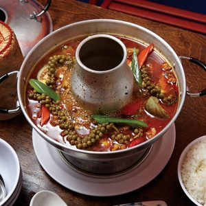 Fire in the hole: Gaeng pa nok saap, jungle curry hot pot with wild ginger, young peppercorns, Thai eggplant, and basil with minced chicken thigh