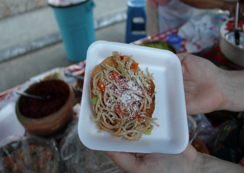 Chow mein tostada at a market in San Benito, Guatemala
