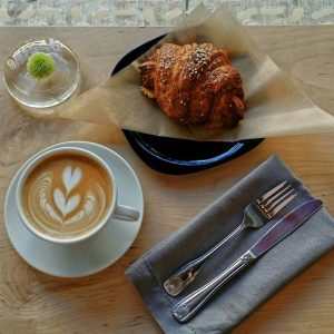 Latté and pastry at Document Coffee Bar