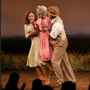 Vanessa Williams and Blair Underwood carry Cicely Tyson off the stage during the curtain call