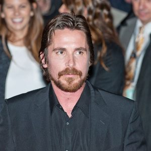 Christian Bale leaves a press conference for American Hustle