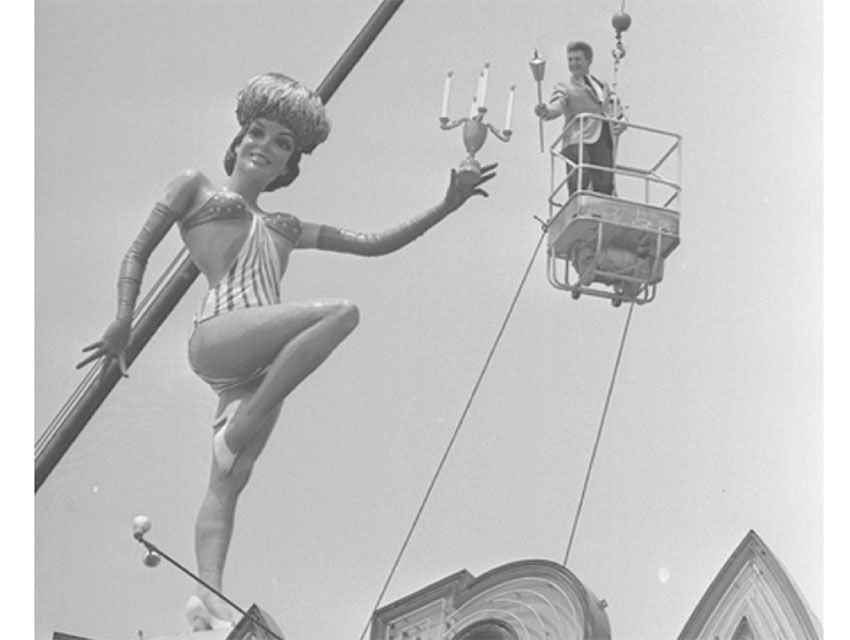 Liberace, hoisted by crane, above the Sahara Hotel billboard on the Sunset Strip in 1966.