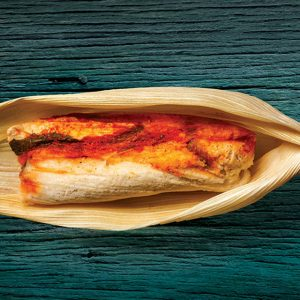 On weekend mornings in East L.A., look for women  with ice chests and a crowd. They're selling homemade tamales.