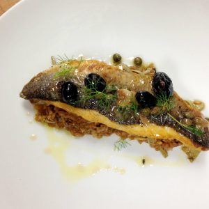 Union's Feast of the Seven Fishes branzino is prepared with farro, artichokes, olives, and Salmoriglio.