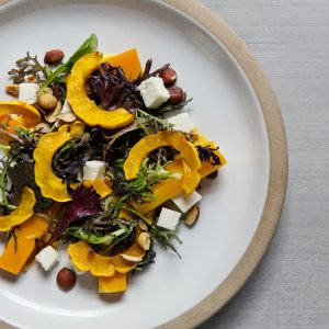 Redbird's delicata squash salad has Oregon hazelnuts, goat's-milk feta, spicy greens, and a sherry vinaigrette.