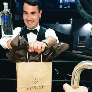 No, that's not Photoshop. This Saucey flair bartender, Flairin' Farron, is balancing a bottle of Absolut on his elbow.