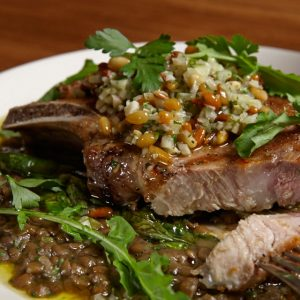 18-ounce bone-in pork chop, lentils, chicories, plum, pine nut gremolata