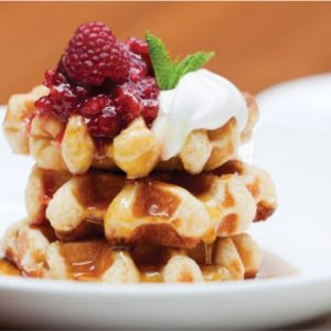 You can load up on waffles while people-watching at Culina.