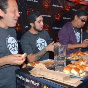 Competitors crush sliders at Dog Haus' contest.