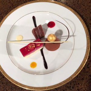 The dessert trio includes Cassis Lemon Cheesecake, Chocolate Alliance Salted Caramel, and Hazelnut Dacquoise.