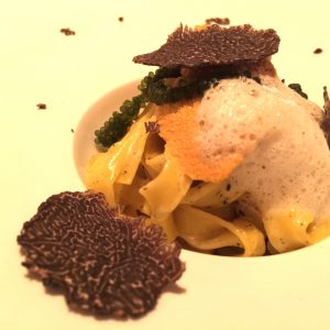 Uni pasta with black truffle air is one of the 16 courses Saam is serving for the next month.