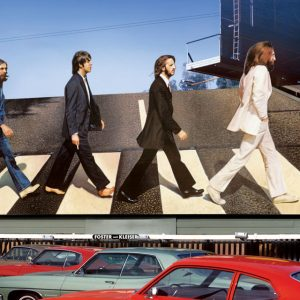 "Robert Landau's 1969 photo of the Abbey Road billboard (above) led to a project that lasted more than a decade. The project included signage for UFO (slide 2), Eddie Money, and Cher (both on slide 3). In 2012, Landau used Facebook to find the guy who stole Paul McCartney's head from the billboard after the photo was taken. ""I drove out to his home in the San Fernando Valley,"" he says, ""and there it was, on his living room wall."""