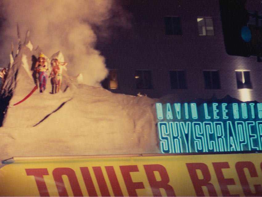 "David Lee Roth delivers his album ""Skyscraper"" by repelling down a replica of the Matterhorn on the roof of Tower Records."