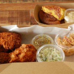 PFC serves fried chicken, coleslaw, and cornbread with honey butter.