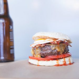 Get a burger like the Red Eye (with Tillamook cheddar, tomato, applewood-smoked bacon, a sunny-side-up egg, and sweet sriracha on an English muffin) for free in Westlake Village.