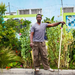 Ron Finley in front of his parkway garden.