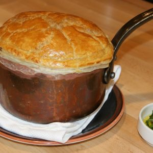 This is how the lamb pot pie arrives at Steak & Whisky.
