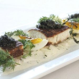Kevin Kathman serves smoked sturgeon at The Larchmont.