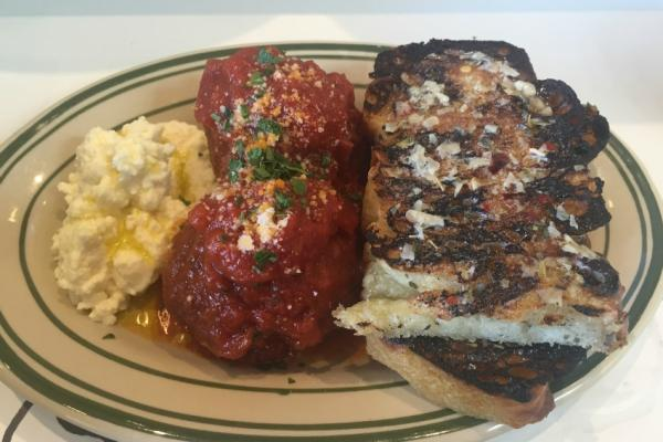 Jon & Vinny's serves pork, beef, and veal meatballs with ricotta and garlic bread.
