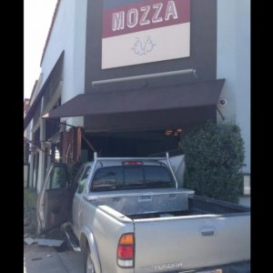Osteria Mozza's front door was damaged by a car accident on Saturday.