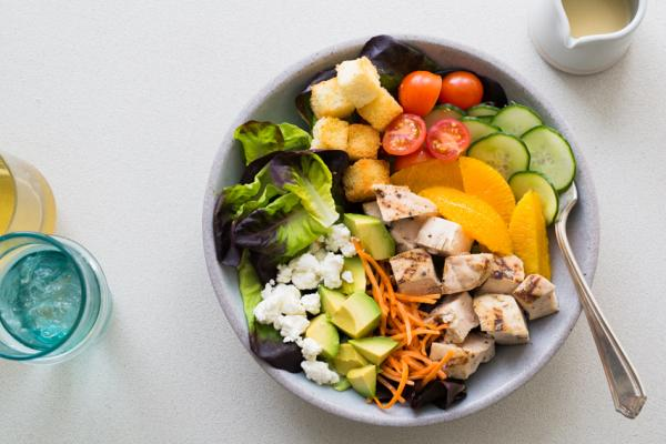 Grilled Chicken Summer Salad with cucumber, avocado, tomato, goat cheese, and muscat