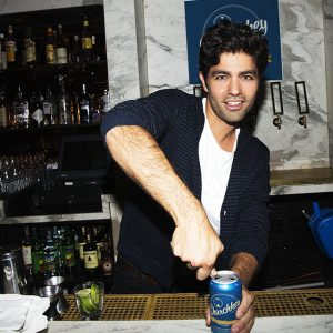 Churchkey co-founder Adrian Grenier flexing that forearm.