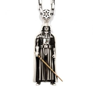 Han Cholo sterling silver Darth Vader pen- dant with gold-plated lightsaber and red and green cubic zirconia; $370 at hancholo.com