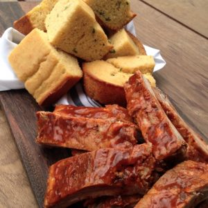 "Baby back ribs and cornbread are part of the ""smokey"" menu planned for Smokey Robinson's performance"