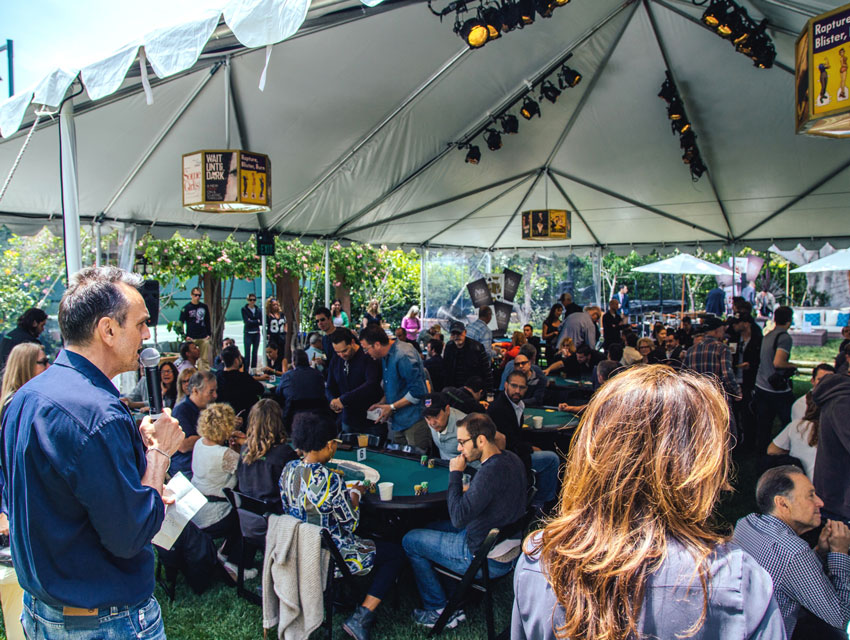 Hank Azaria thanking Aria Resort & Casino in his opening speech for the  no-limit hold'em tournament that took place in a beautiful tent with a lounge in the corner adorned with Aria pillows