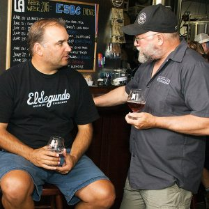 El Segundo founder Rob Croxall chats with Cascade Brewing's Ron Gansberg during L.A. Beer Week in June
