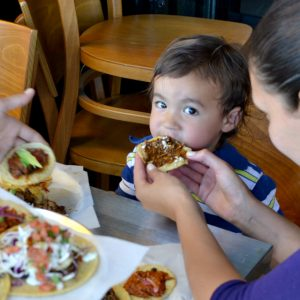Matthew adorably chows down on some mole poblano tacos at Guisados