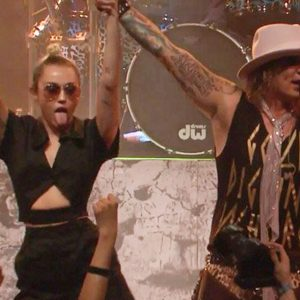 MIley Cyrus and Steel Panther's Michael Starr.