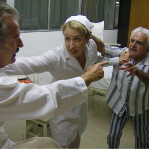 John Nielsen as Schindler, Heather Robinson as nurse, and Ray Xifo as Neutra