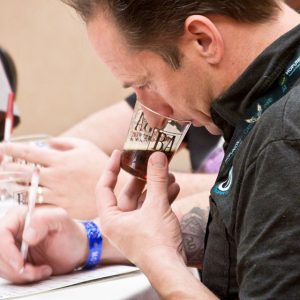 A GABF judge sniffs an entry in one of the many categories of beer