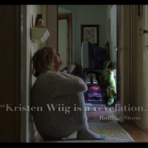 Kristen Wiig cries into a sweater
