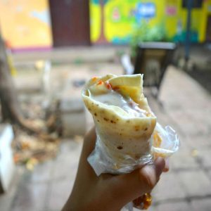 A Nicaraguan-style quesillo wrapped in a thick corn tortilla