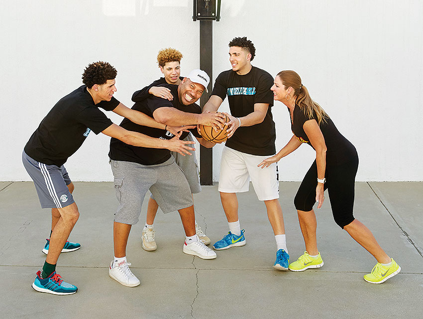 LaVar Ball (second from left) and his wife, Tina, ham it up with their boys on the basketball court at home